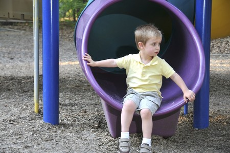A young boy on a slide at a park Stock Photo - 6915045