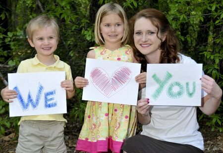 A single mom and her son and daughter holding signs Stock Photo - 6915423