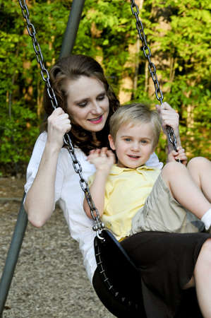 A mom and her son on a swing Stock Photo - 6919434