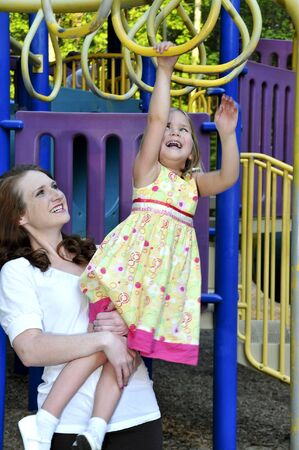 A mom playing at the park with her daughter Stock Photo - 6919417
