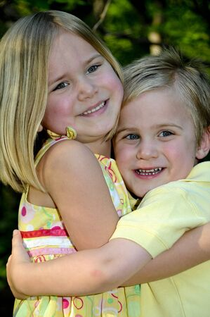 A happy little boy and girl brother and sister Stock Photo - 6916444