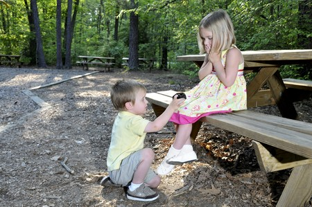proposing: A little boy proposing marriage to a little girl
