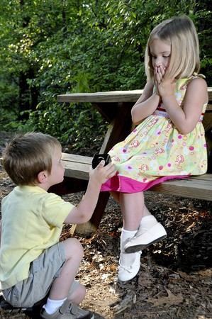 little boy and girl: A little boy proposing marriage to a little girl
