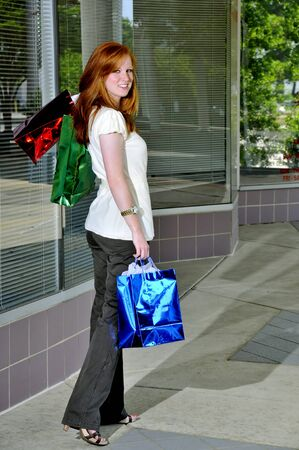 A beautiful young woman on a shopping spree Stock Photo - 7045301
