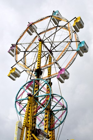 midway: A large ferris wheel or big wheel at a fair. Stock Photo