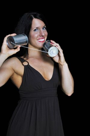 A woman talikng on a primative phone Stock Photo - 7146513