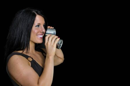 A woman talikng on a primative phone Stock Photo - 7146485