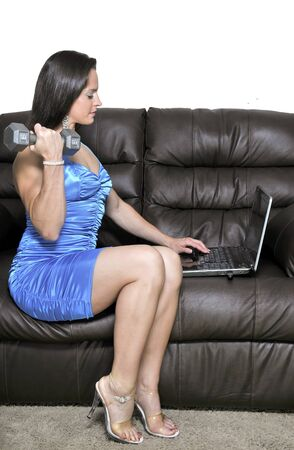 A woman using a computer while working out photo
