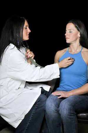 A beautiful young female doctor examaning a beautiful woman Stock Photo - 7146491