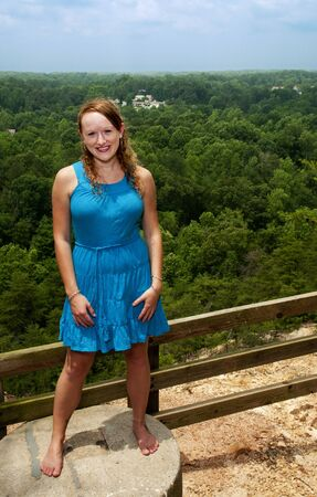A beautiful woman at a mountain overlook photo