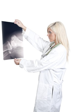 A beautiful female radiologist examining an x-ray photo