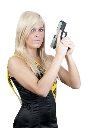 Ayoung and beautiful woman holding a handgun Stock Photo - 7240704
