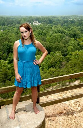 overlook: A beautiful woman at a mountain overlook