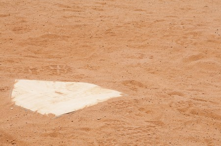 The home plate on a baseball field photo