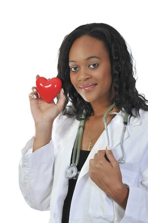 A beautiful female doctor holding a heart Stock Photo - 7365138