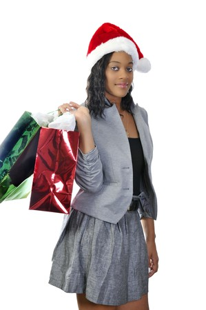 boxing day sale: A beautiful young woman wearing a Santa hat Stock Photo