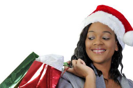 A beautiful young woman wearing a Santa hat Imagens