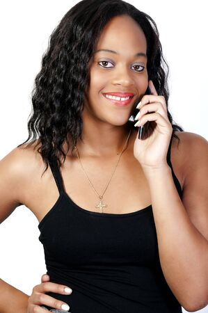mobile communication: An African American woman talking on the phone