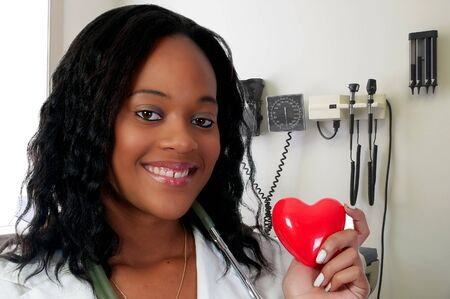 A beautiful female doctor holding a heart Stock Photo - 7461996