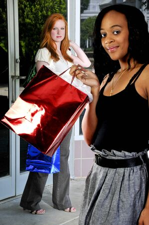 Beautiful young women on a shopping spree Stock Photo - 7462028