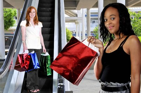 Beautiful young women on a shopping spree Stock Photo - 7462036