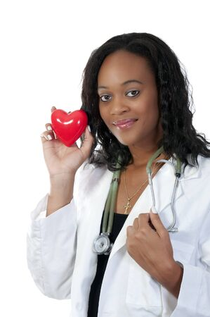 A beautiful female doctor holding a heart Stock Photo - 7461942