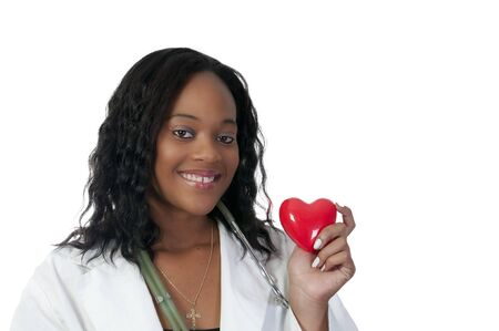 A beautiful female doctor holding a heart Stock Photo - 7462026