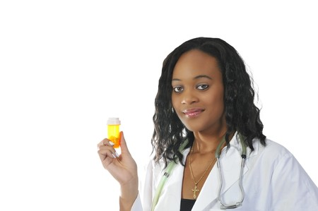An doctor holding prescription medication in her office Stock Photo - 7461987
