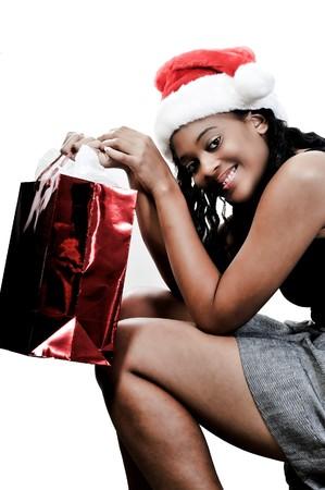 A beautiful young woman wearing a Santa hat photo