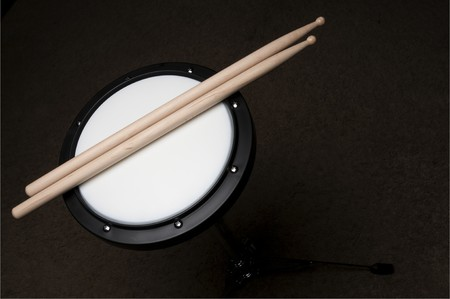 percussionist: An instructional Drum Practice Pad used for learning drums Stock Photo