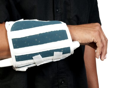 An African American man with a broken arm Imagens
