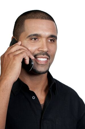 An African American man talking on the phone photo