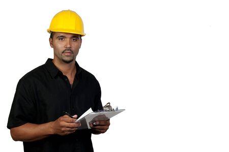 inspector: A male construction worker a job site.