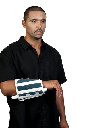 An African American man with a broken arm photo