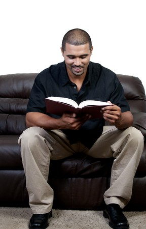 A handsome black man reading a book photo