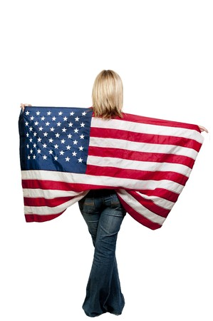 A beautiful young woman holding an American flag. Stock Photo - 7803782