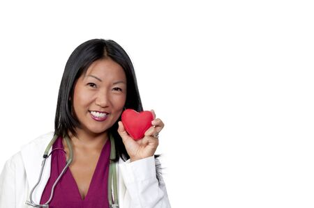 A female cardiologist holding a red heart Stock Photo - 7803866