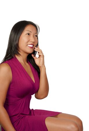 phone: A beautiful woman using a cell phone Stock Photo