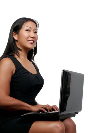 A beautiful computer savvy young woman using a laptop photo