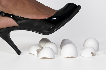 stepping: A woman in high heels walking on eggshells