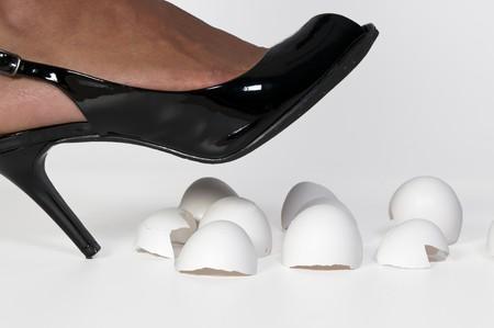 stepping: A woman in high heels walking on eggshells