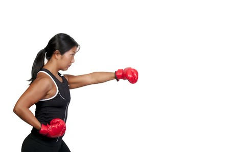 gloves women: A beautiful young woman wearing a pair of boxing gloves