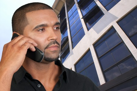 african american male: An African American man talking on the phone