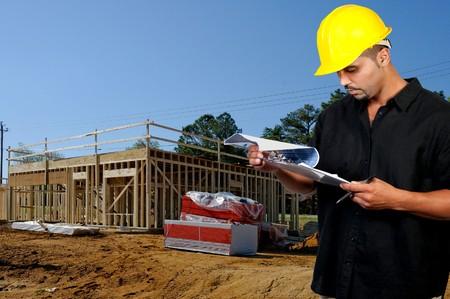 panoya: A male construction worker a job site.
