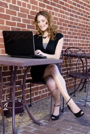 savvy: A beautiful computer savvy young woman using a laptop