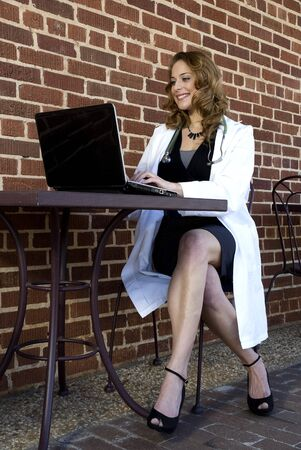 A female doctor working on a laptop computer photo