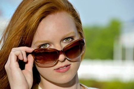 A beautiful woman wearing a pair of sunglasses Stock Photo - 7956664