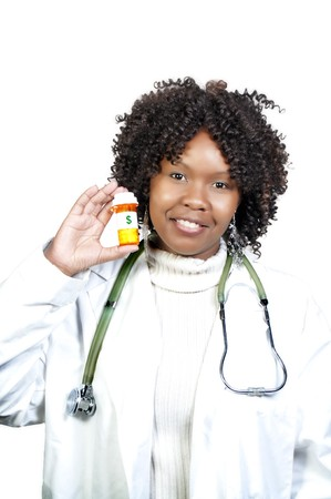 An doctor holding a bottle of prescription medication  photo