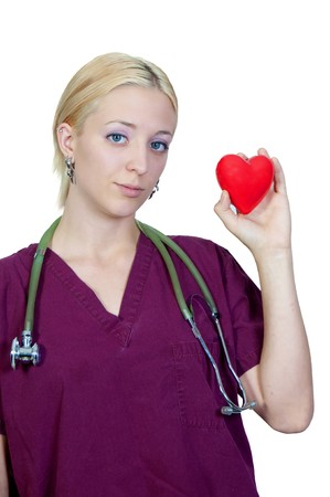 A female cardiologist holding a red heart photo