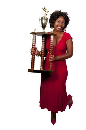 women holding cup: A beautiful woman holding a large trophy